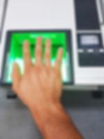 Side view from a man using a fingerprint