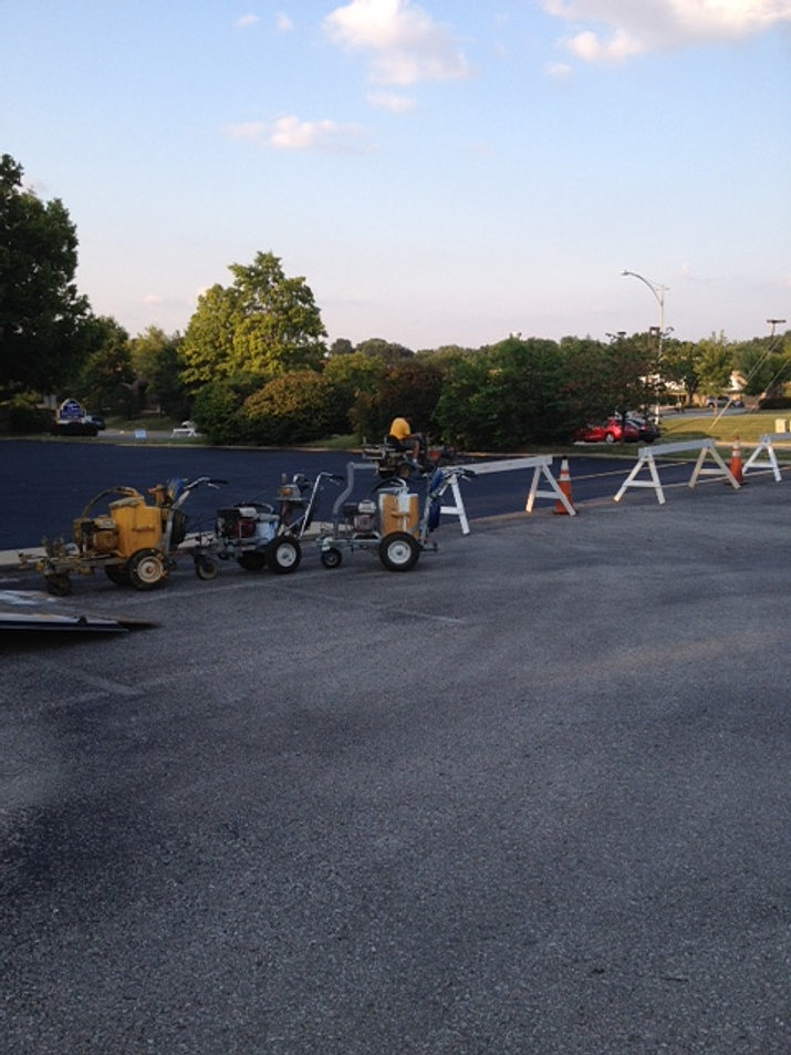 Acs parking lot striping orlando for Parking lot painting equipment