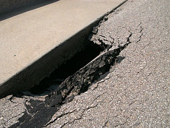 how to fix parking lot cracks