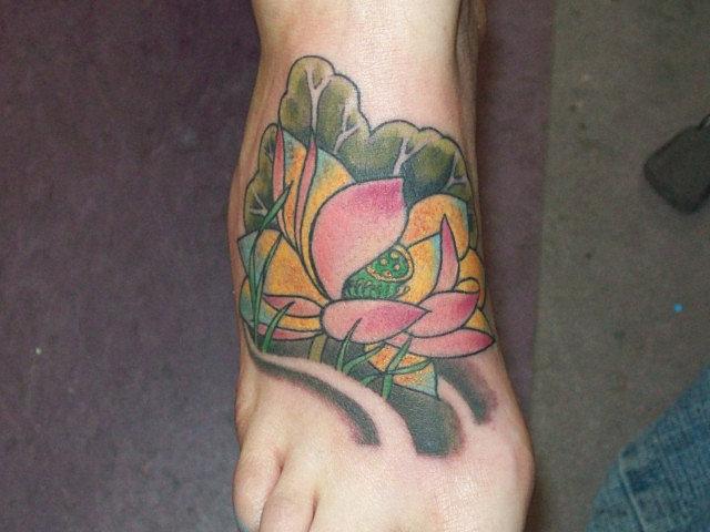 Tabernacle tattoo tampa lotus flower tattoo for Tattoo shops in ybor