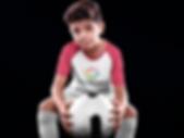 custom-soccer-jerseys-kid-holding-the-ba