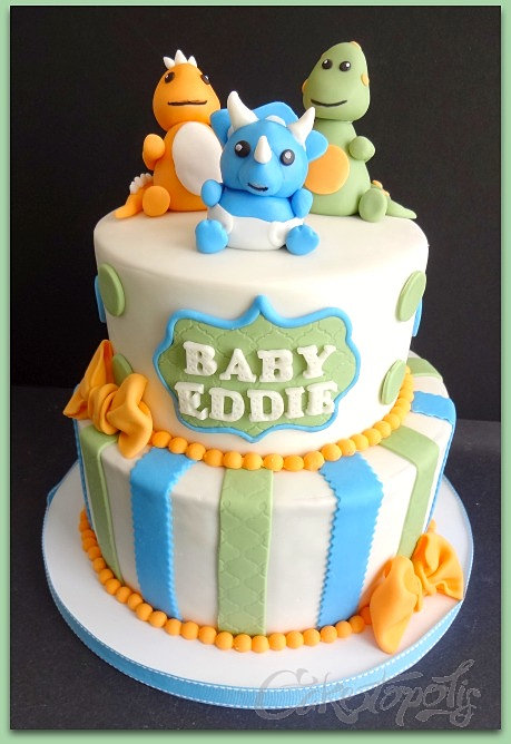 two tier dinosaur baby shower cake green blue and orange accents