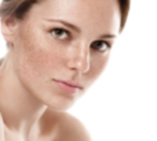 Young beautiful freckles woman face port