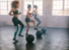 Young women exercising in aerobics class