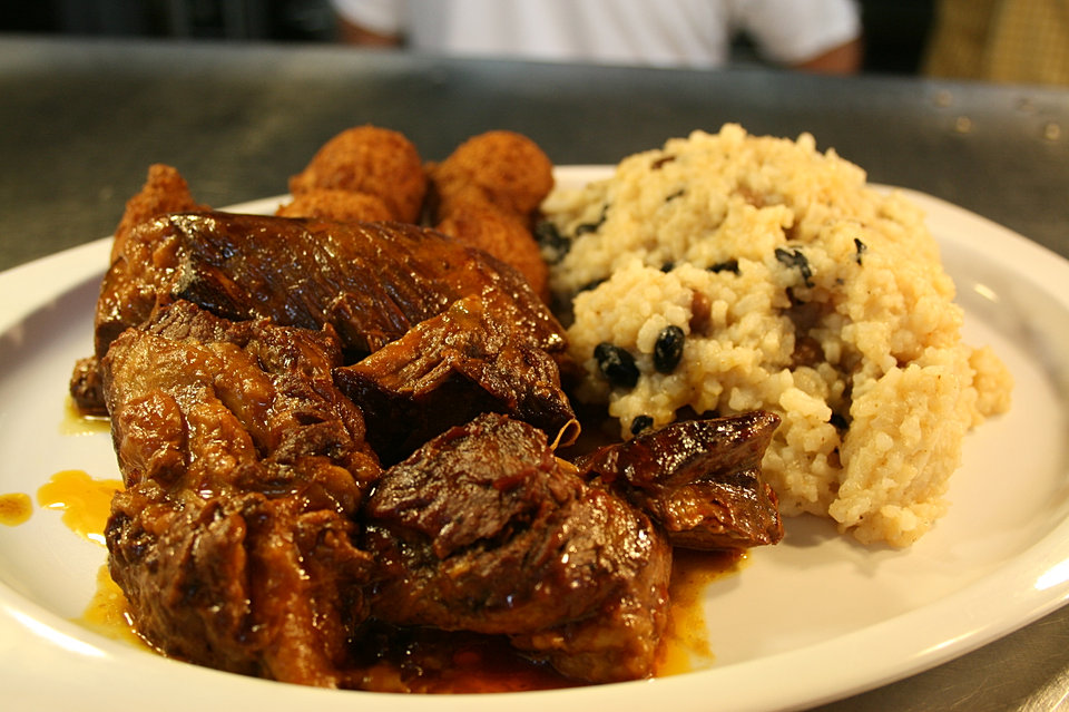 Boneless Country Ribs with Black Beans Rice and Hush Puppies