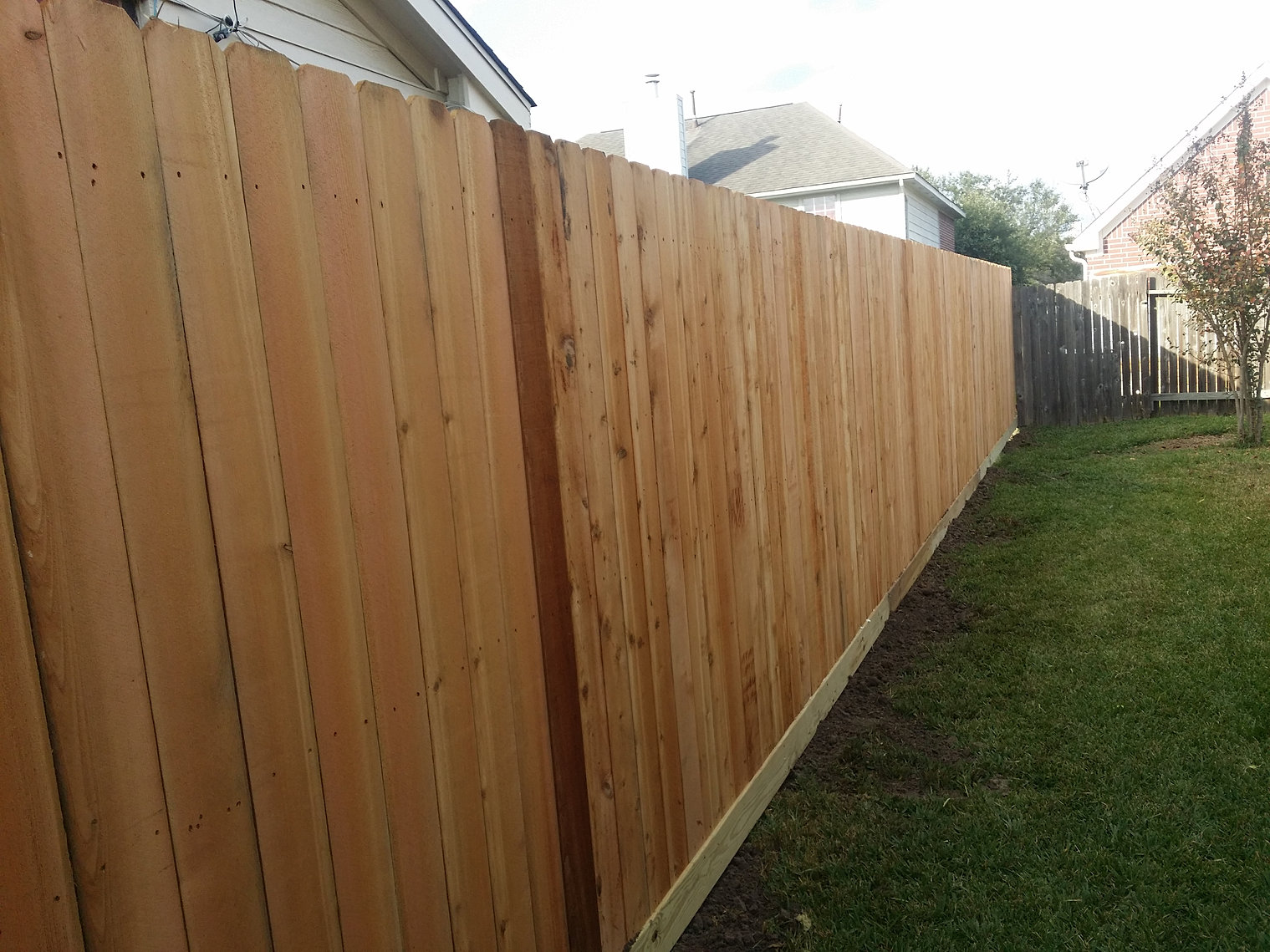 Wood fencing houston tx humble tx standard wooden fence with rot board baanklon Gallery