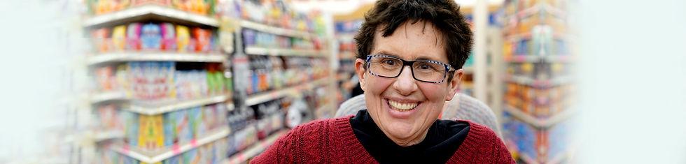 Individual smiling while shopping