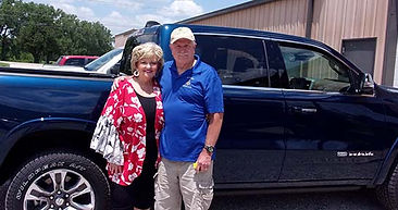 21st Drawing Raffle Winners Gary & Tresa Thomas standing in front of their new 2021 Dodge Ram.