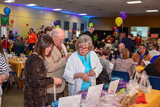 Cruise Night Guests look at items up for silent auction.
