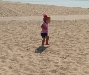 Sophia walking at the beach