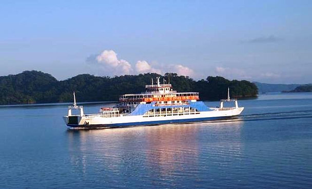 Cross the gulf of Nicoya by ferry, then go to Santa Teresa, (or Tambor, Montezuma, Cobano))