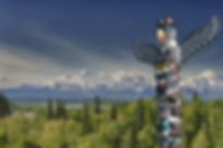 Indigenous Totem Pole mountain backgroun