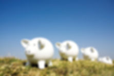Four piggy banks on a hill