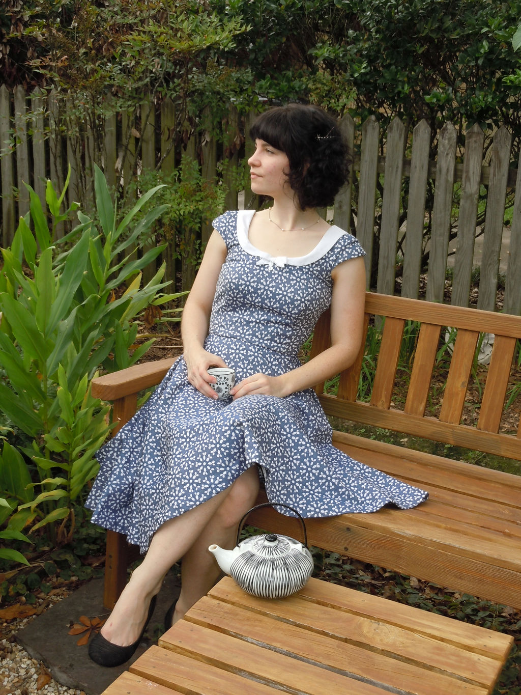 blue jacquard dress with a full circle skirt and white collar with button detail