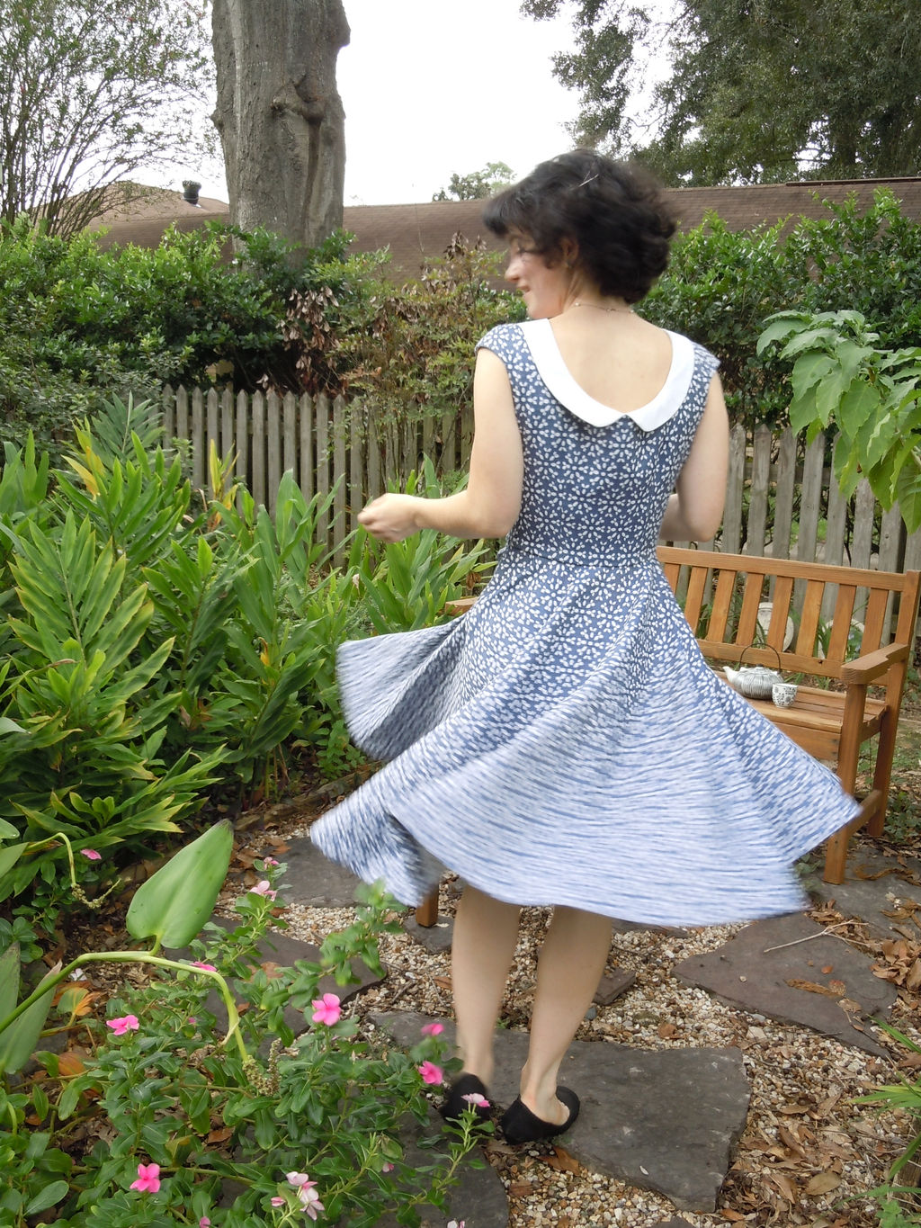 blue jacquard dress with a full circle skirt and white collar and button detail