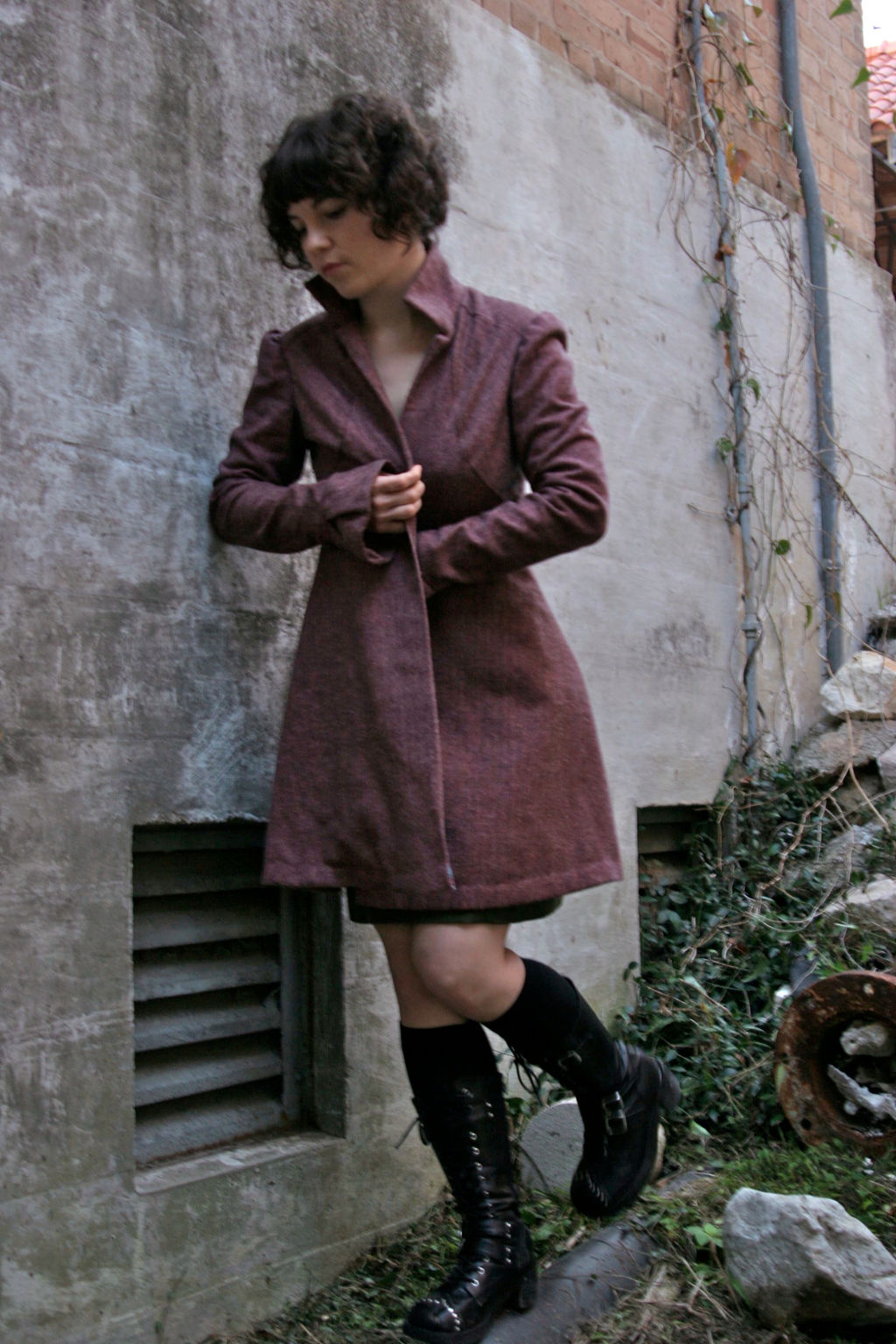 long pink herringbone coat with radiating seams on the bodice, leg of mutton sleeves, pleated cuffs and flared skirt