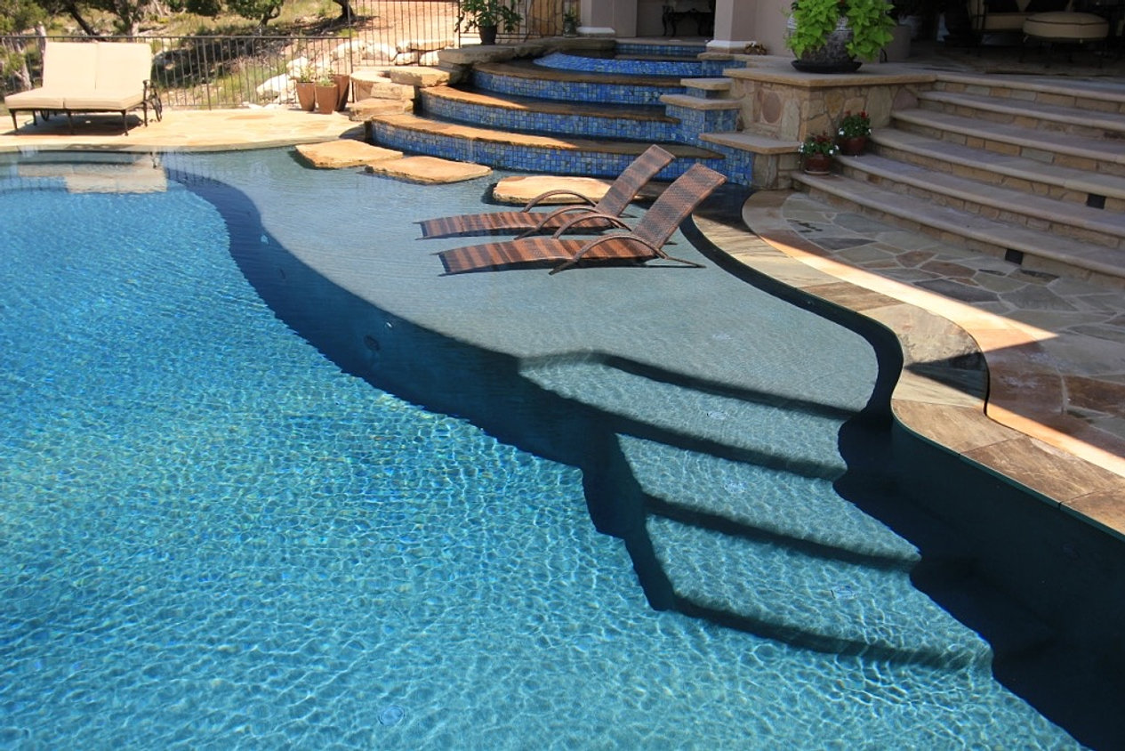 Beach entry pools elite pools of austin for Pool design with tanning ledge