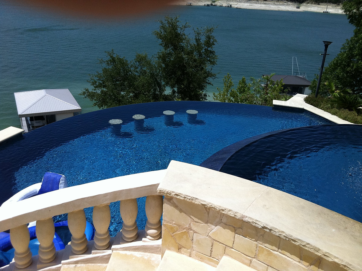 Negative edge pools elite pools of austin for Pool edges design