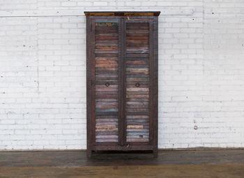 Two Door Tall Shutter Cabinet