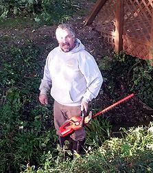 Joe Working on the church grounds.jpg
