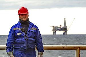 Oilman shift workers on the deck of the