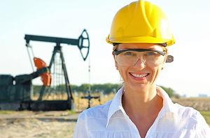 Smiling Female Engineer in an Oilfield.j
