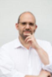 Daniel Sobel Hand on Face.jpg