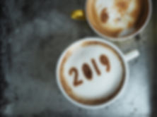 White cup of coffee with the number 2019