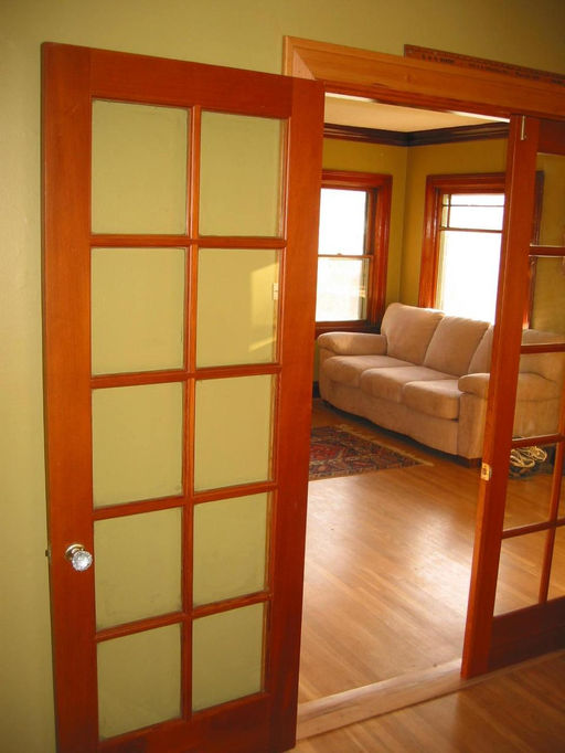 Vintage carpentry door installation and repair for French doors that both open