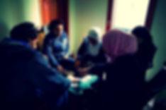 Lebanese family playing cards