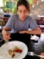 Leila Eating the Torta Hrapoćuša at Konoba Toni in Dol, Brač, Croatia