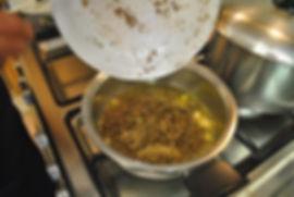 Adding grated truffle to oil - Spaghetti Truffle Recipe