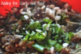 Adding basil, garlic, to the strained and mashed eggplants - Marietta's Calabrese Braciole di Melanzane Recipe