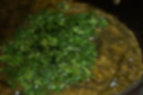 adding the cilantro to the soup, molokhia recipe, lebanese recipes