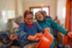Amal laughing in her home in Ketermaya, Lebanon