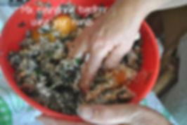 Mixing ingredients with hands - Marietta's Calabrese Braciole di Melanzane Recipe