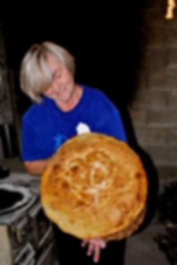 Maritza Holding her Peka Bread, Peka Bread Recipe, Imotski, Croatia
