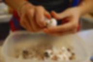Popping off the stems from the mushrooms, White Mushroom Arugula Salad Recipe