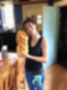 Leila Elamine from the Recipe Hunters with fresh homemade Challah Bread