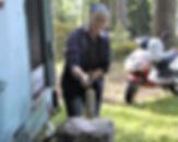 Lillemor chopping wood for the Tunnbröd Recipe, Böllnas, Sweden