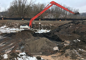 excavator carrying out environmental clean-up and removal of contaminated soils