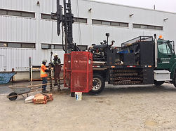 Truck-mounted drill-rig on project site