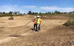 Survey crew on area grading job