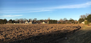 A cultivated field, prior to residential subdivision development.