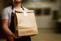 Person-Holding-Brown-Paper-Delivery-Bag-