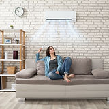 WOMAN WITH DUCTLESS BRICK WALL.jpg
