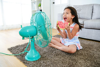 Girl with Watermelon and fan blowing.jpg