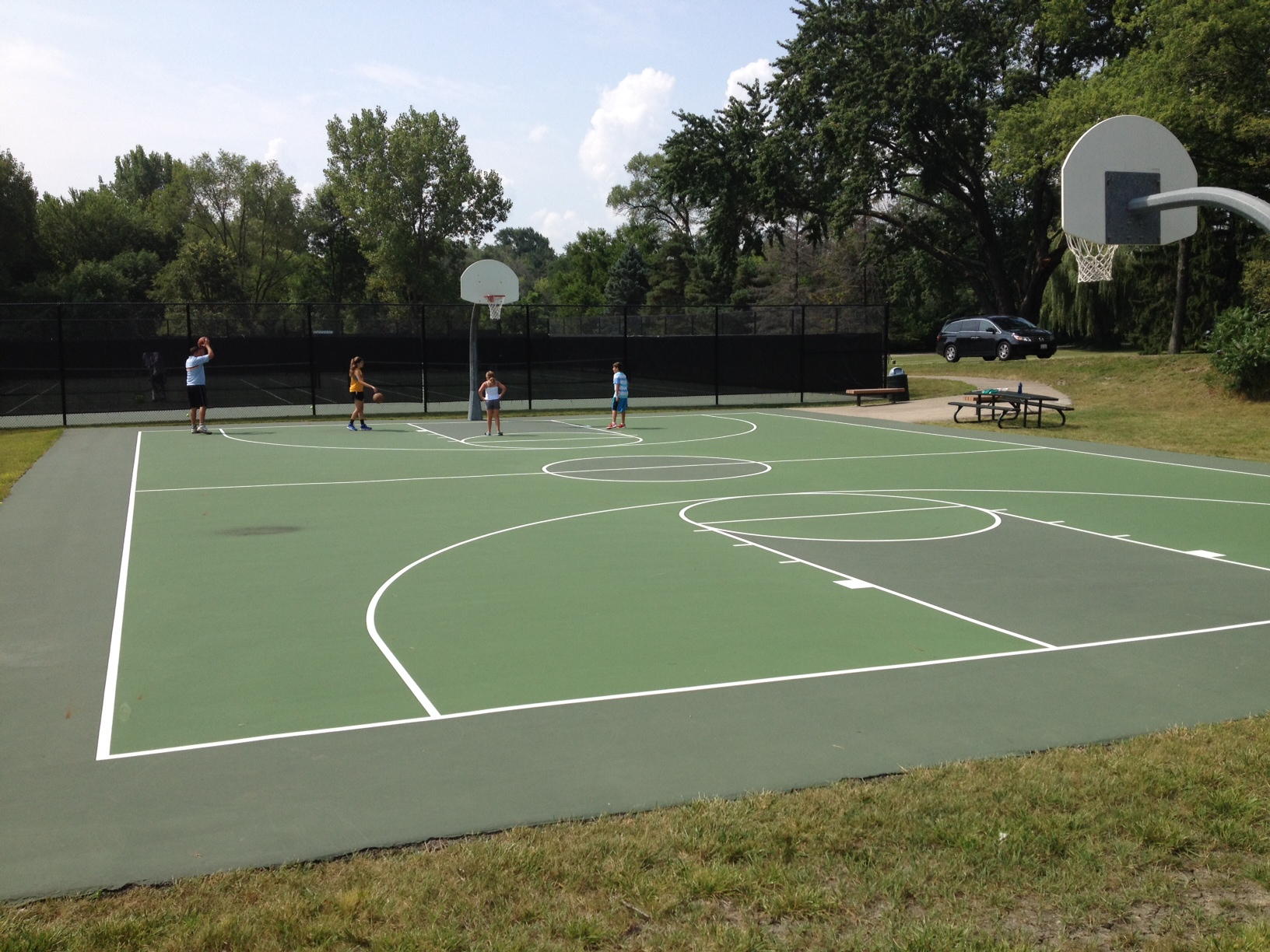 Indoor outdoor sports surfaces mtj sports mtj sports for Indoor basketball court installation