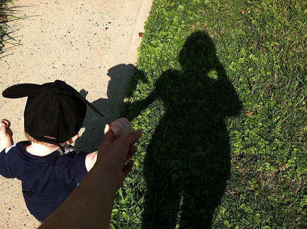 My son and I walking, our shadows in front of us.