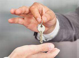 Close-up Of A Person Handover Keys To Ma